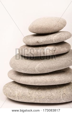 Balanced Grey Stones Over White Background With Copy Space