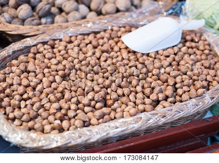 Hazelnuts are sold on the market. Dried fruits