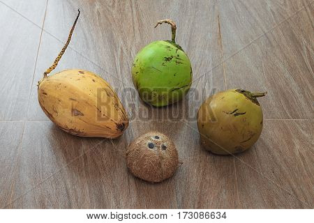 Four different coconuts on table horizontal top view