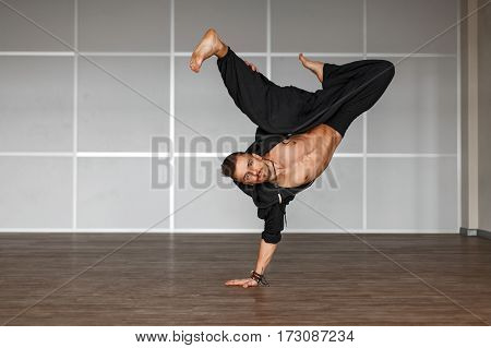 Professional Dancer Dancing Man On The Floor. Man Standing On The Hand