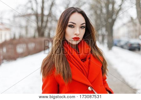 Beautiful Young Woman In Red Fashion Clothes Walking In A Winter Park