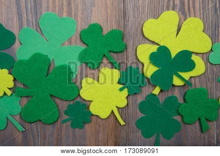 Leaves Of Clover On Brown Wooden Background. St.patricks Day
