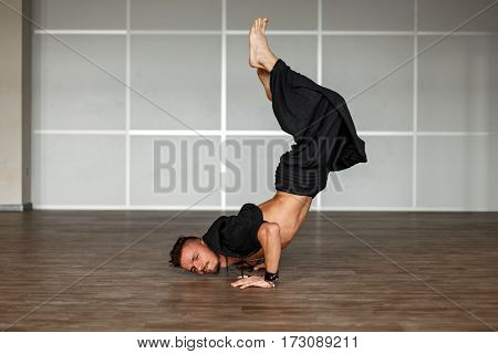 Stylish Dancer Man In Black Clothes Dancing