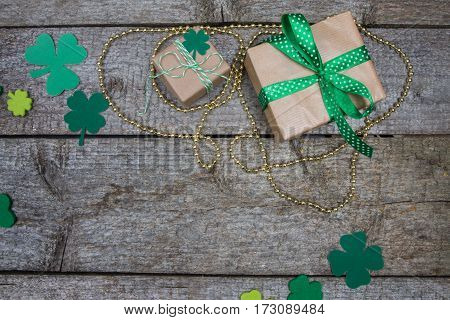 Two Gift In Kraft Paper And Clover Leaves. Patricks Day