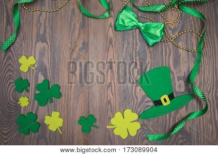 Traditional Irish Background With Hat Patrick, Bow And Clover Leaves