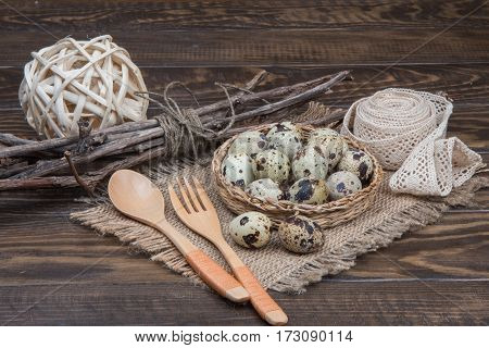 Easter Set Quail Eggs On Wicker Tray, Wooden Spoon, Fork