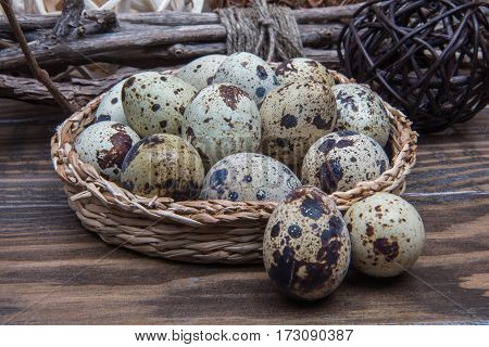 Wicker Dish With Quail Eggs Closeup. Traditional Easter Food