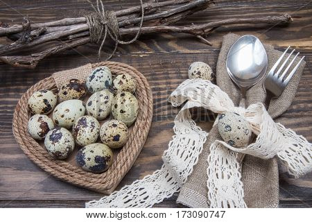 Table Setting For Easter Dinner. Quail Eggs, Spoon And Fork