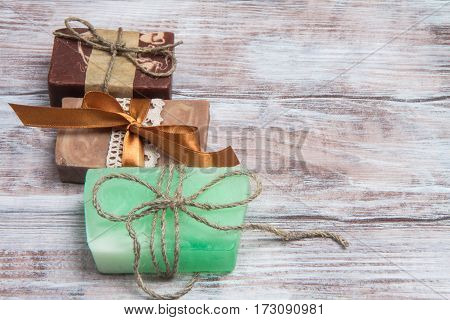 Three Colored Natural Handmade Soap On Wooden Table