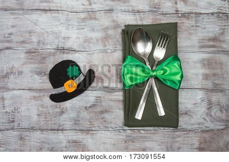 St. Patricks Hat, Clover Leaf, Spoon And Fork On Wooden Table