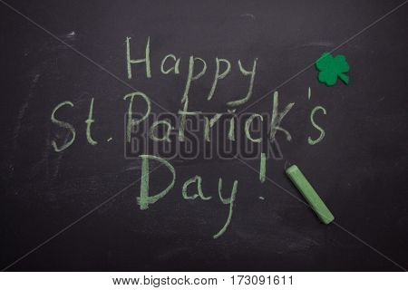 Chalkboard With Words Happy St Patricks Day, Shamrock And Pencil