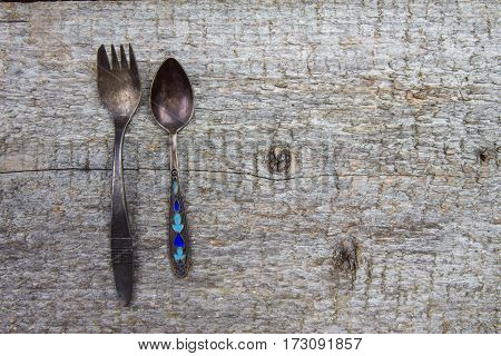 Vintage Little Fork And Spoon On Old Shabby Wooden Table