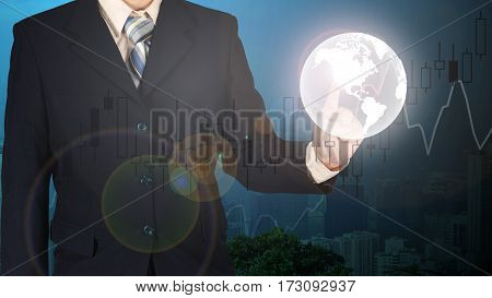 Double Exposure Of The World On Businessman Hand Cityscape Blurred Building Background, Financial Gr