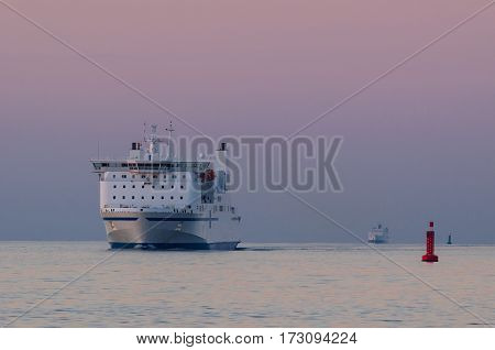 FERRY PASSENGER/CAR - The ferry on calm sea at sunset