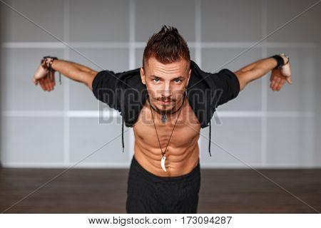 Stylish Handsome Man Dancer Posing In Dance Movement