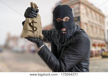 Happy Robber Is Showing Stolen Bag Full Of Money.