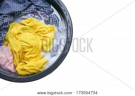 Soak dirty clothes in the basin black for clean isolated on white background and clipping path