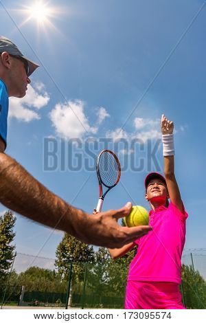 Tennis training, toned image, outdoors, selective focus