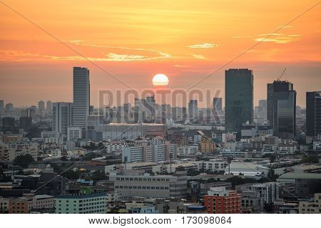Aerial view of urban city skyline at sunrise cityscape in downtown of Bangkok Thailand