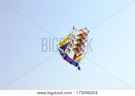 Kite-shaped boat and with rainbow colors on the beach of Bamburi in Kenya