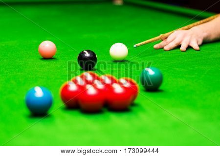 snooker - hand aiming the cue ball