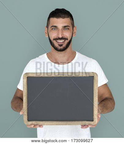Man Holding Chalkboard Smiling Happy