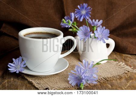 Cup Of Tea With Chicory On Wooden Background