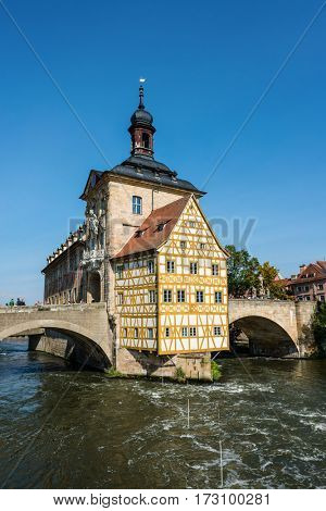 Old historic baroque Town Hall, Bamberg, Germany with its timbered frescoed walls built on an island in the Regnitz River accessed by two arched stone bridges