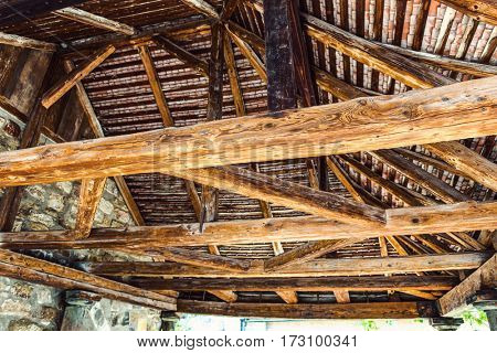 Interior framework of stone and wooden building as seen from a low angle view