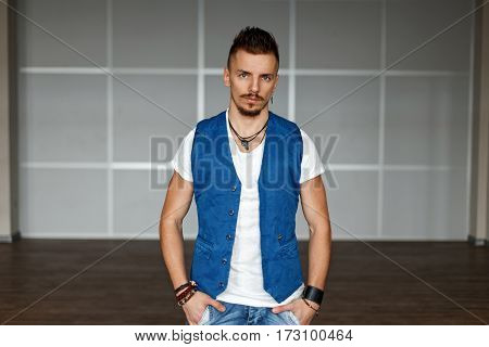 Handsome Man With Hair In A Stylish Clothes Standing In Office.