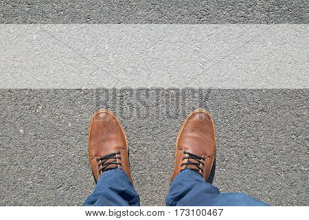 Brown male Shoes on street. Top Down view