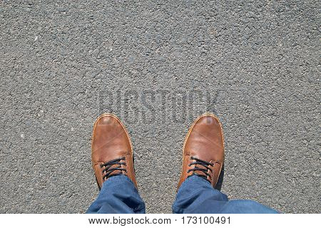 Brown male Shoes on street, top down view