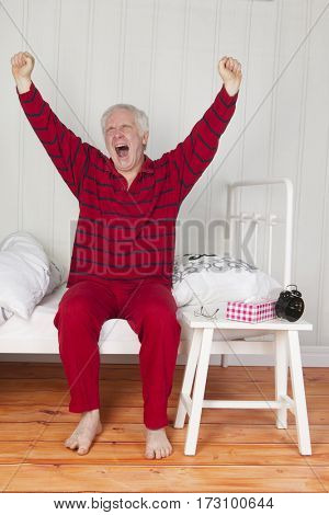Retired man is waking up in the morning