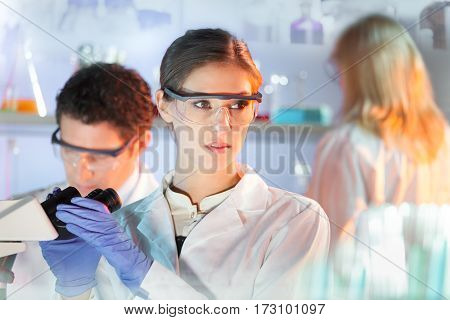 Life science researchers in scientific genetic laboratory.