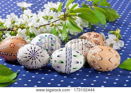 Easter Eggs And Blossom On The Blue Tablecloth