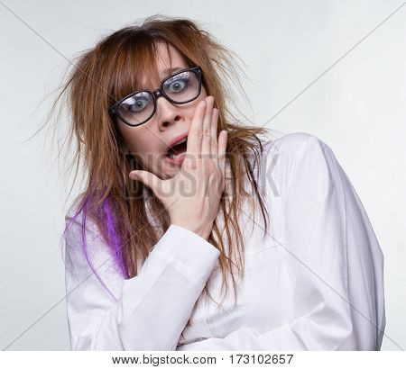 Gossip scientist shaggy woman on gray background