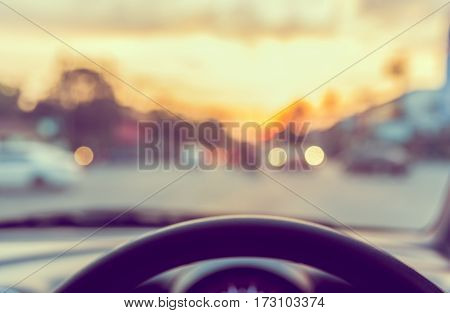 Vintage Tone Blur Image Of People Driving Car On Day Time.