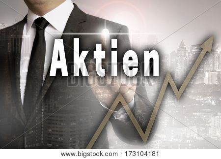 Aktien (in German Shares) Is Shown By Businessman Concept