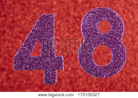 Number forty-eight purple color over a red background. Anniversary. Horizontal