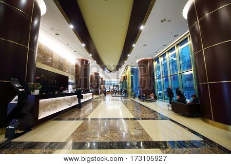 MOSCOW - OCT 20, 2016: People in hall in Empire tower in Moscow city business center, Empire Business Complex - 60-story skyscraper built in 2006
