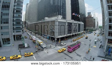 NEW-YORK - AUG 23, 2014: Hilton Midtown Manhattan Hotel on Avenue of the Americas with traffic at summer day. Aerial view. Hilton has more than 540 locations in 78 countries.