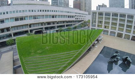NEW-YORK - AUG 22, 2014: Lincoln Center with Juilliard School and Avery Fisher Hall near Hearst Plaza with Paul Milstein Pool and Terrace. Aerial view. Lincoln Center built in 1955â??1969.