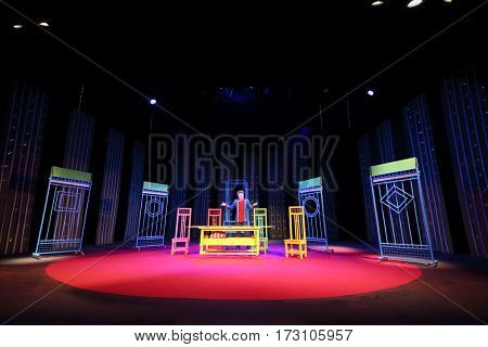 MOSCOW - OCT 19, 2016: Actor near table on stage during Premium class Performance in Modern theater