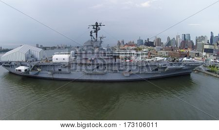 NEW-YORK - SEP 07, 2014: Ship USS Intrepid (CV-11) with Sea-Air-Space museum on pier 86 near city at autumn day. Aerial view. Ship was decommissioned in 1974.