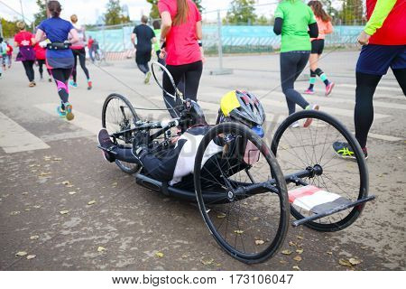 MOSCOW - SEP 25, 2016: Disabled man in wheelchair during Promsvyazbank Moscow marathon amateurs and professionals again ran 42.2 km on central streets and quays of Moscow