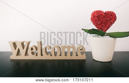 warm Welcome sign with heart flower pot