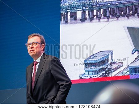 MUNICH GERMANY - FEBRUARY 16 2017: Bosch Software Innovations CEO Rainer Kallenbach delivers an address to IBM Genius of Things Summit in Munich Germany on February 16 2017.