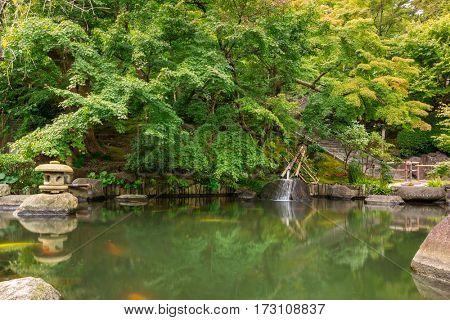 Idyllic pond in the park of Kamakura, Japan