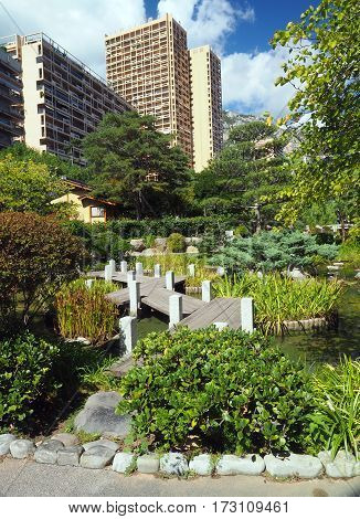 Japanese Garden walkway path Monte Carlo Monaco Europe condominium in background