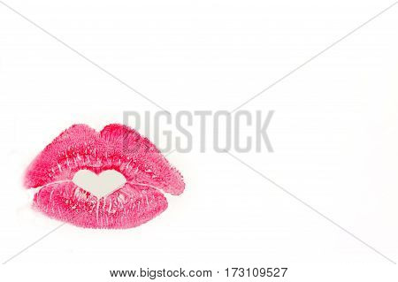 Perfect imprint of pink lipstick. Silhouette of pink lips isolated on white background. Qualitative trace of heart lipstick texture. Can be used as a decorative element for print or design.